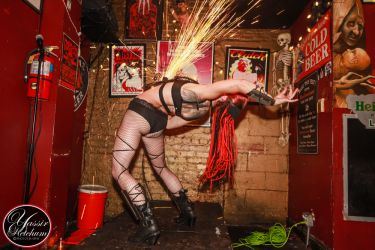 Angle Grinder Girl Act Shooting Sparks Crotch Sideshow Performer Show Plates Chest Steel Sasha FireGypsy Connecticut 1