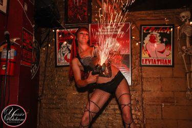 Angle Grinder Girl Act Shooting Sparks Crotch Sideshow Performer Show Plates Chest Steel Sasha FireGypsy Massachusetts 1