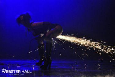Angle Grinder Girl Act Shooting Sparks Crotch Sideshow Performer Show Plates Chest Steel Sasha FireGypsy  Webster Hall MA Nightclub