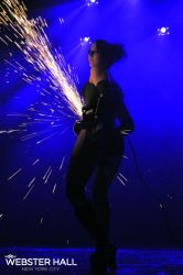 Angle Grinder Girl Act Shooting Sparks Crotch Sideshow Performer Show Plates Chest Steel Sasha FireGypsy Webster Hall NH Nightclub
