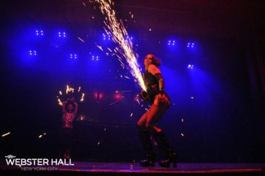 Angle Grinder Girl Act Shooting Sparks Crotch Sideshow Performer Show Plates Chest Steel Sasha FireGypsy Webster Hall NYC Nightclub