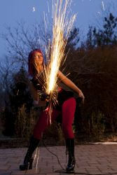 Massachusetts Halloween Angle Grinder Girl Act Shooting Sparks Crotch Sideshow Performer Show Steel Plates Metal Grinding Fire Dancer 1